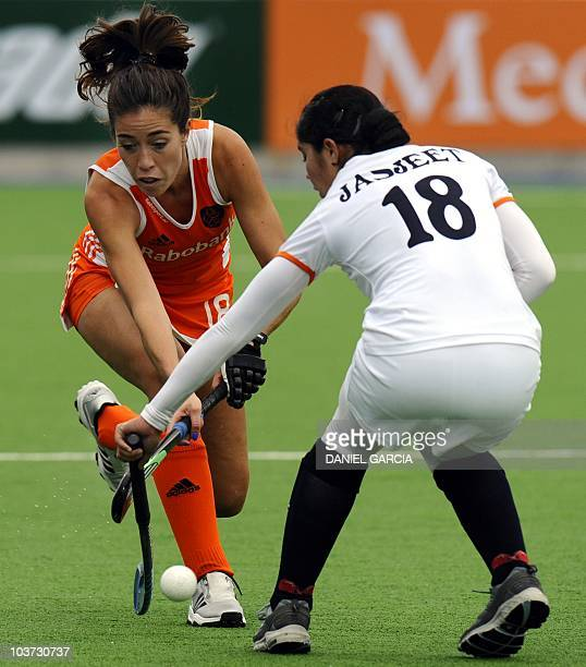 Netherlands' Naomi Van As vies for the ball with India's Jasjeet Kaur Handa during their field hockey Group A match for the Women's World Cup 2010 in...