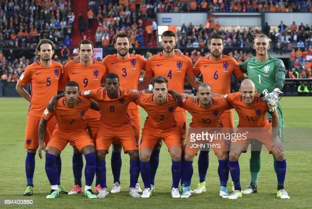 Netherlands' national football team players defender Daley Blind forward Vincent Janssen defender Stefan de Vrij defender Wesley Hoedt midfielder...