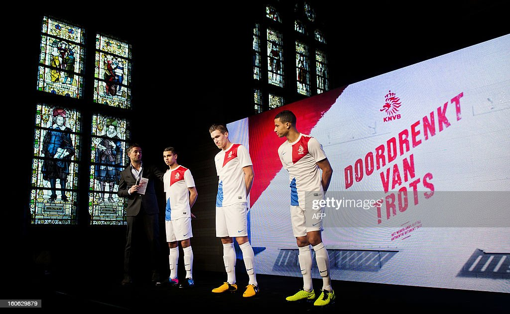 Netherlands national football's players Adam Maher (2ndL), Kevin Strootman (C) and Ricardo van Rhijn (R) pose during the presentation of their new jersey on February 4, 2013 at the Rijksmuseum in Amsterdam. The team will play in a white jersey with red and blue areas. AFP PHOTO / ANP KOEN VAN WEEL / netherlands out