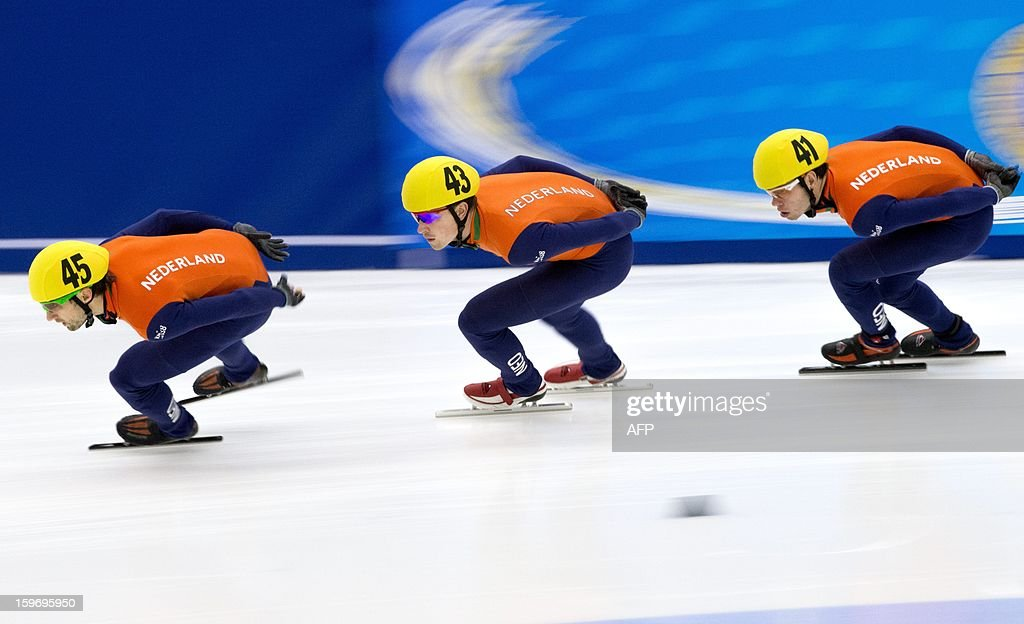 Netherland's Niels Kerstholt (L) and his compatriots Freek Van Der Wart (C) and Sjinkie Knegts compete during the men's 1500m event of the 2013 ISU European Speedskating Championships in Malmo Sweden on January18, 2013. Knegts won the event ahead of his compatriot Kerstholt (2nd) and Italy's Yuri Confortola (3rd) AFP PHOTO / SCANPIX SWEDEN / PONTUS LUNDAHL SWEDEN OUT