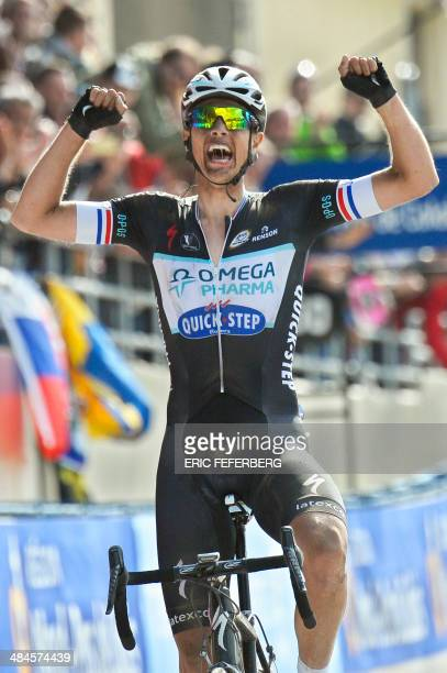 Netherland's Niki Terpstra reacts as he crosses the finish line to win the 112th edition of the ParisRoubaix oneday classic cycling race on April 13...