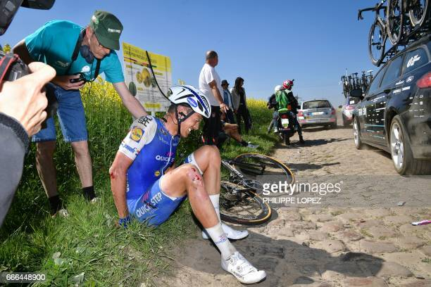 Netherlands' Niki Terpstra sits after falling during the 115th edition of the ParisRoubaix oneday classic cycling race between Compiegne and Roubaix...