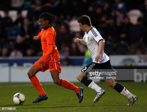 Netherlands' Patrick van Aanholt and Scotland's Ryan Jack battle for the ball