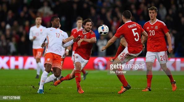 Netherlands player Georginio Wijnaldum challenges Joe Allen of Wales during the friendly International match between Wales and Netherlands at Cardiff...