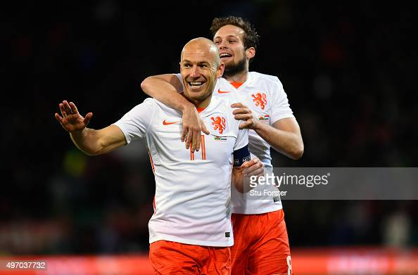 Netherlands players Arjen Robben and Daley Bind celebrate the second Dutch goal during the friendly International match between Wales and Netherlands...