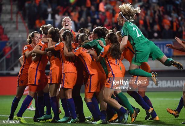 Netherlands' players celebrate after their third goal during the UEFA Womens Euro 2017 football tournament semifinal match between Netherlands and...