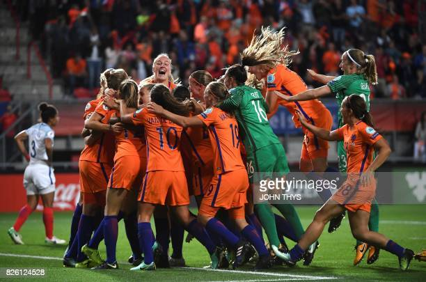 TOPSHOT Netherlands' players celebrate after winning during the UEFA Womens Euro 2017 football tournament semifinal match between Netherlands and...