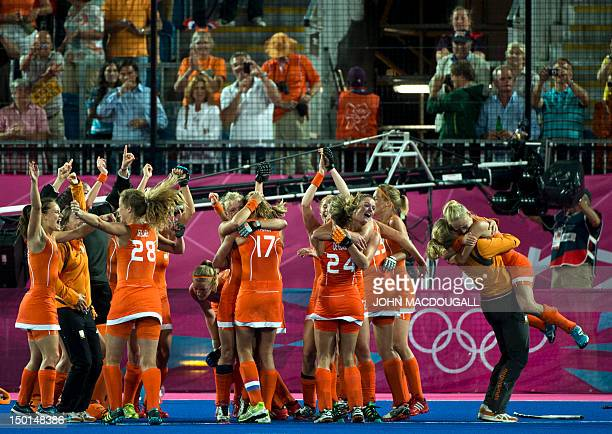 Netherlands players celebrate following the women's field hockey gold medal match between Netherlands and Argentina at The Riverbank Arena in London...