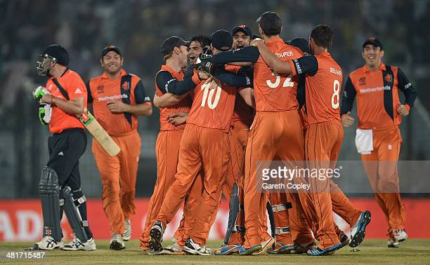 Netherlands players celebrate the final wicket of James Tredwell of England to win the ICC World Twenty20 Bangladesh 2014 Group 1 match between...