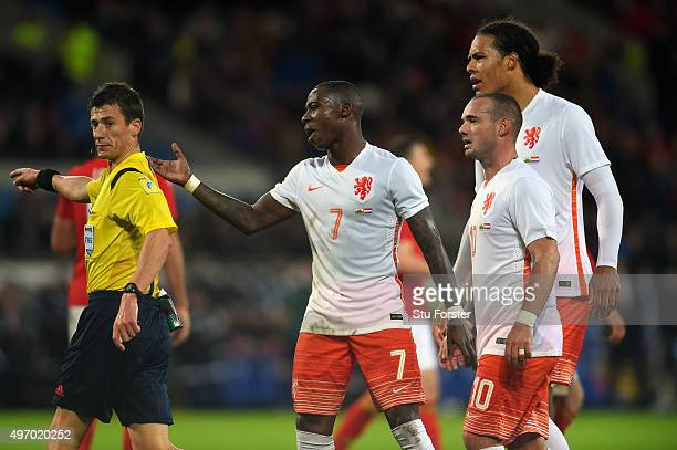 Netherlands players led by Quincy Promes despute the penalty award by referee Benoit Bastien during the friendly International match between Wales...