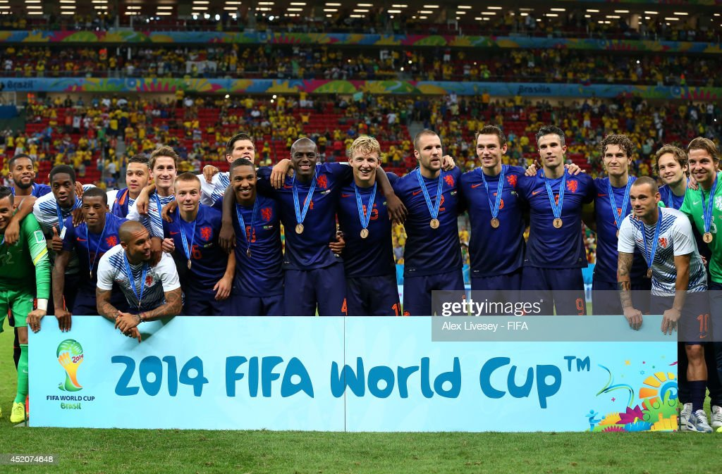 Netherlands players pose for photographs during the medal ceremony after the 2014 FIFA World Cup Brazil 3rd Place Playoff match between Brazil and Netherlands at Estadio Nacional on July 12, 2014 in Brasilia, Brazil.