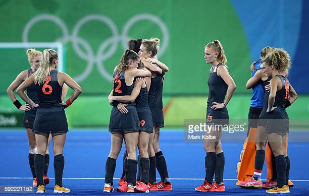 Netherlands players react after losing to Great Britain in the Women's Gold Medal Match on Day 14 of the Rio 2016 Olympic Games at the Olympic Hockey...