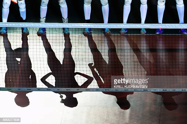 TOPSHOT Netherlands' players wait for the start of the women's quarterfinal volleyball match between South Korea and the Netherlands at the...