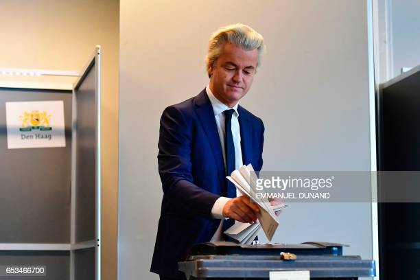 TOPSHOT Netherlands' politician Geert Wilders of the Freedom Party casts his ballot for Dutch general elections at a polling station in The Hague on...