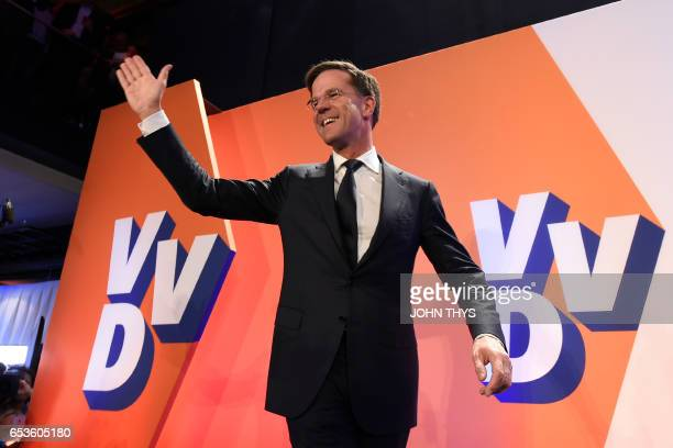 TOPSHOT Netherlands' prime minister and VVD party leader Mark Rutte celebrates after winning the general elections in The Hague on March 15 2017 The...