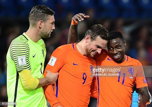 Netherlands' Quincy Promes and Netherlands' Vincent Janssen celebrate after their team's victory during the FIFA World Cup 2018 qualification...