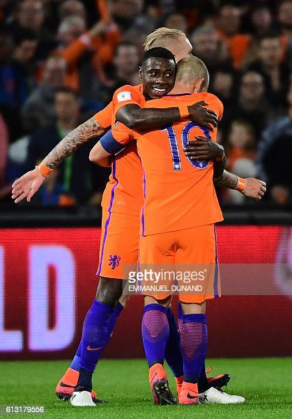 Netherlands' Quincy Promes celebrates after scoring his second goal during the World Cup 2018 football qualification match between The Netherlands...