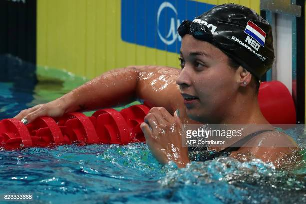 Netherlands' Ranomi Kromowidjojo reacts after competing in a women's 100m freestyle heat during the swimming competition at the 2017 FINA World...