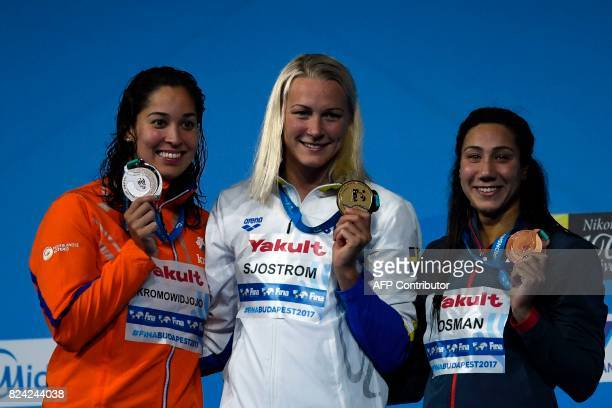 Netherlands' Ranomi Kromowidjojo Sweden's Sarah Sjostrom and Egypt's Farida Osman celebrate on the podium after the women's 50m Butterfly final...