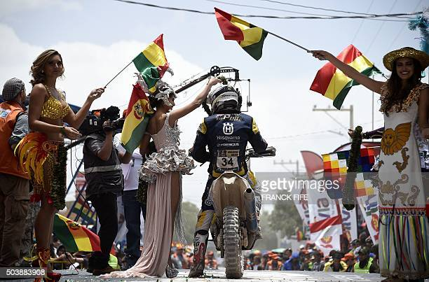TOPSHOT Netherlands' Robert JR Van Pelt poses on the podium at the end of the Stage 5 of the Dakar Rally 2016 between Jujuy in Argentina and Uyuni...