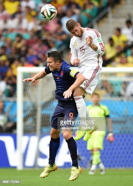 Netherland's Robin van Persie and Spain's Sergio Ramos battle for the ball