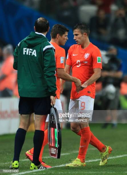 Netherland's Robin van Persie is replaced by teammate KlaasJan Huntelaar