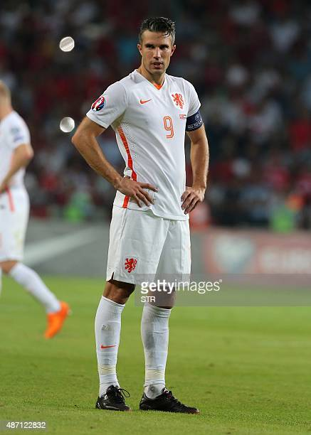 Netherland's Robin Van Persie look on at the end of the Euro 2016 qualifying match between Turkey and Netherlands at the Arena Stadium in Konya on...
