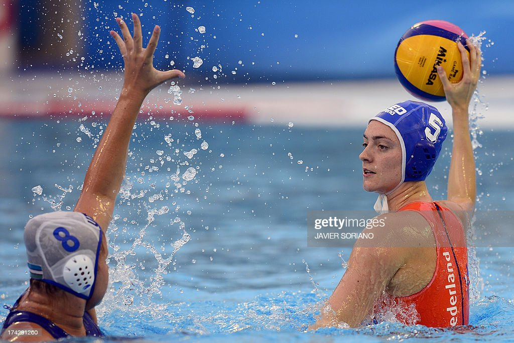 Netherlands' Sabrina van der Sloot (R) vies with Uzbekistan's Anna Shcheglova (L) during the preliminary round match between Uzbekistan and Netherlands in the women's water polo competition at the FINA World Championships in Bernat Picornell pools in Barcelona on July 23, 2013.