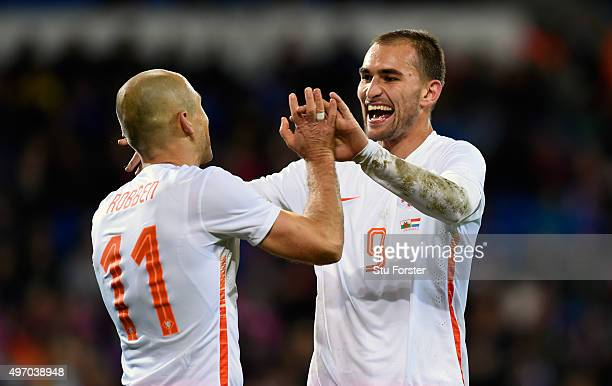 Netherlands scorer Arjen Robben celebrates the third Dutch goal with Bas Dost during the friendly International match between Wales and Netherlands...