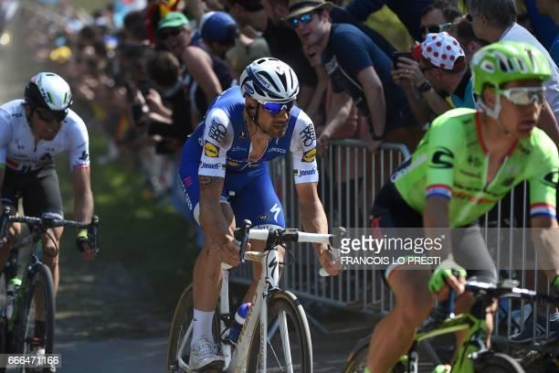 Netherlands' Sebastian Langeveld Belgium's Tom Boonen and Norway's Edvald Boasson Hagen ride on the cobblestones during the 115th edition of the...