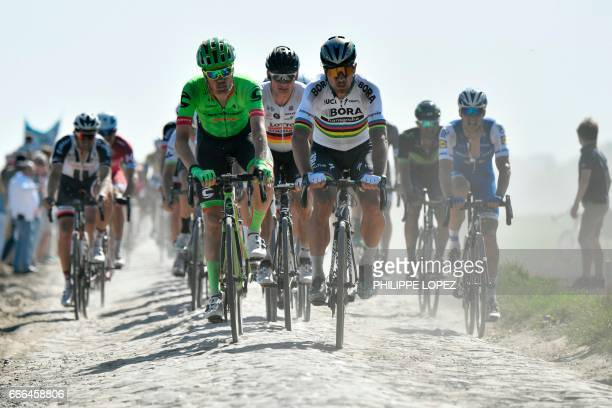 Netherlands' Sebastian Langeveld Germany's Andre Greipel and Slovakia's Peter Sagan ride on the cobblestones during the 115th edition of the...
