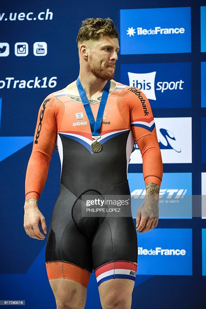Netherlands' silver medalist Roy Van Den Berg poses on the podium of the men's sprint race at the European Track Championships in Saint-Quentin-en-Yvelines on October 22, 2016. / AFP / PHILIPPE