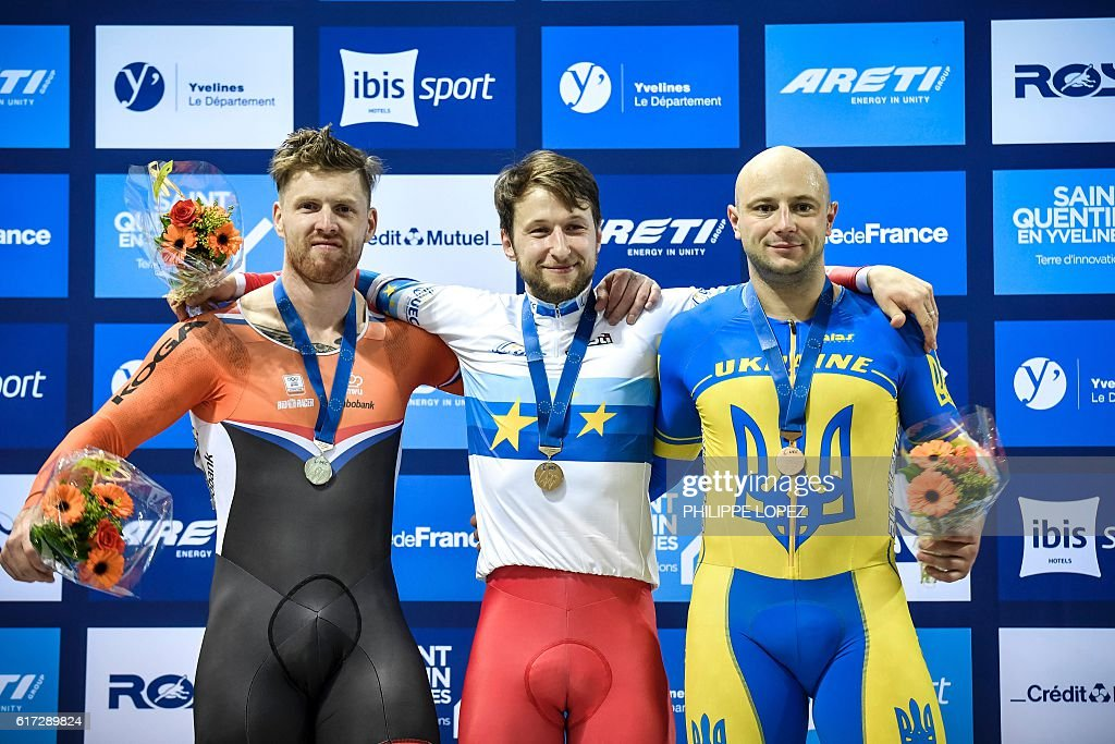 Netherlands' silver medalist Roy Van Den Berg, Russia's gold medalist Pavel Yakushevskiy and Ukraines's bronze medalist Andriy Vynokurov pose on the podium of the men's sprint race at the European Track Championships in Saint-Quentin-en-Yvelines on October 22, 2016. / AFP / PHILIPPE