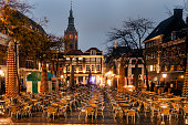 Netherlands, South Holland, Hague, Gothic St. James Church, Town square with cafe tables