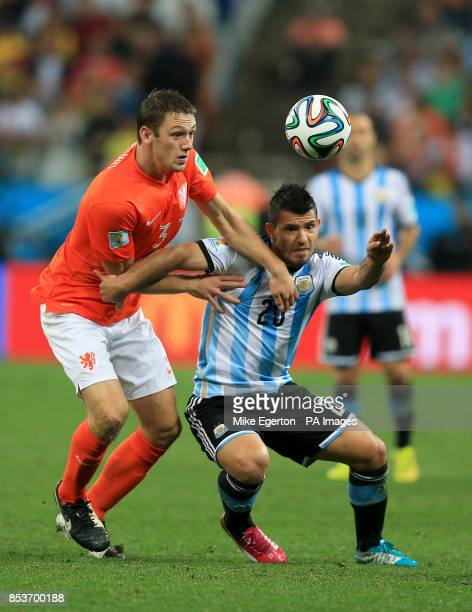 Netherlands' Stefan de Vrij and Argentina's Sergio Aguero battle for the ball during the FIFA World Cup Semi Final at the Arena de Sao Paulo Sao...