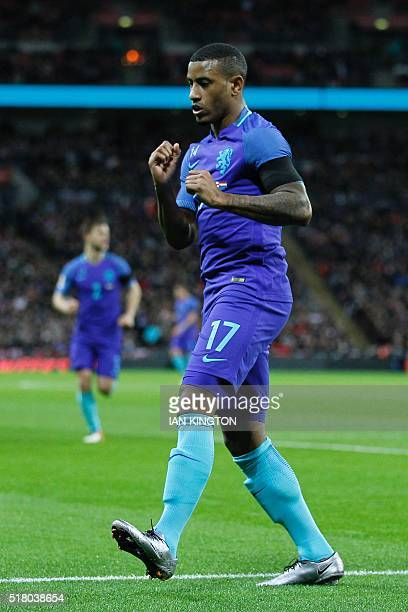 Netherlands' striker Luciano Narsingh celebrates scoring their second goal during the international friendly football match between England and...