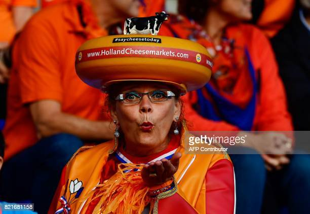 A Netherlands supporter wearing a cheeseshaped hat blows a kiss before the UEFA Women's Euro 2017 football match between Belgium and the Netherlands...