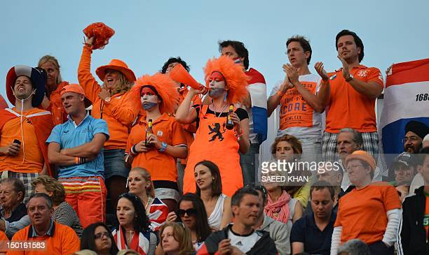 Netherlands' supporters attend the men's field hockey gold medal match Germany vs the Netherlands at the London 2012 Olympic Games in London on...