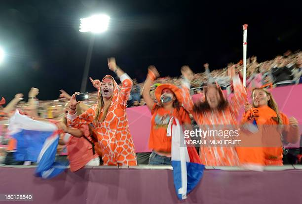 Netherlands supporters celebrate their team's victory in the women's field hockey gold medal match between Netherlands and Argentina at The Riverbank...