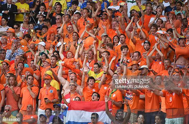 Netherlands' supporters react after their team victory in the Round of 16 football match between Netherlands and Mexico at Castelao Stadium in...