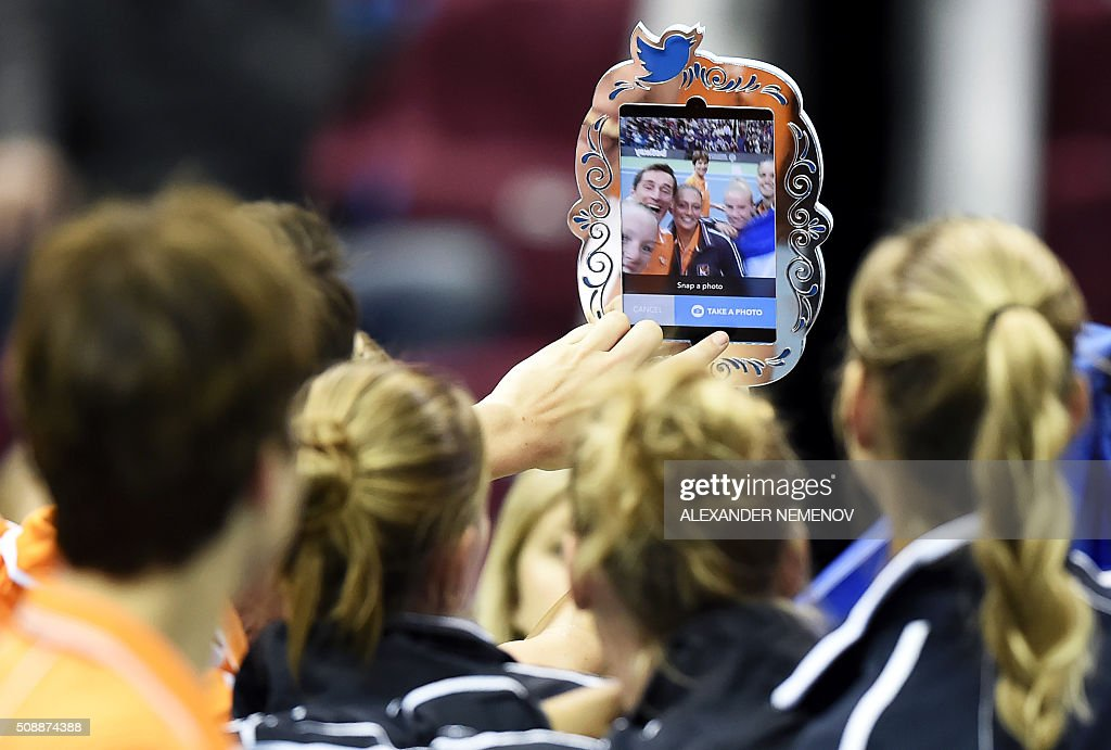 Netherland's team makes a selfie after Kiki Bertens scored the third point of her team following her victory over Russia's Svetlana Kuzntetsova during the Federation Cup tennis world group first round match between Russia and Netherlands in Moscow on February 7, 2016. / AFP / ALEXANDER NEMENOV