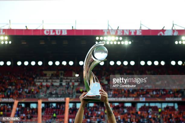 A Netherlands' team player celebrates with the trophy after winning with her tean the UEFA Womens Euro 2017 football tournament final match between...