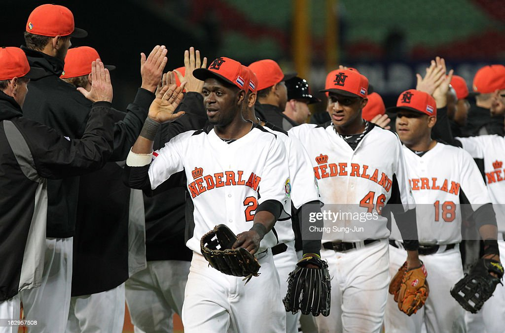 Netherlands team players celebrate after winning against South Korea during the World Baseball Classic First Round Group B match between South Korea and the Netherlands at Intercontinental Baseball Stadium on March 2, 2013 in Taichung, Taiwan.