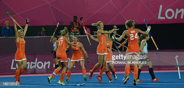 Netherlands teammates celebrate after victory in the women's field hockey gold medal match between Netherlands and Argentina at The Riverbank Arena...