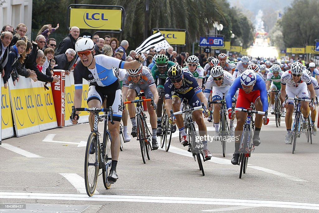 Netherland's Theo Bos celebrates his victory as he crosses the finish line of the 82th Criterium International cycling race's first stage in Porto Vecchio on March 23, 2013. AFP PHOTO / PASCAL POCHARD-CASABIANCA