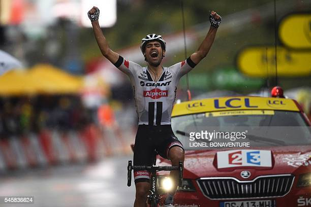 TOPSHOT Netherlands' Tom Dumoulin celebrates as he crosses the finish line of the 1845 km ninth stage of the 103rd edition of the Tour de France...