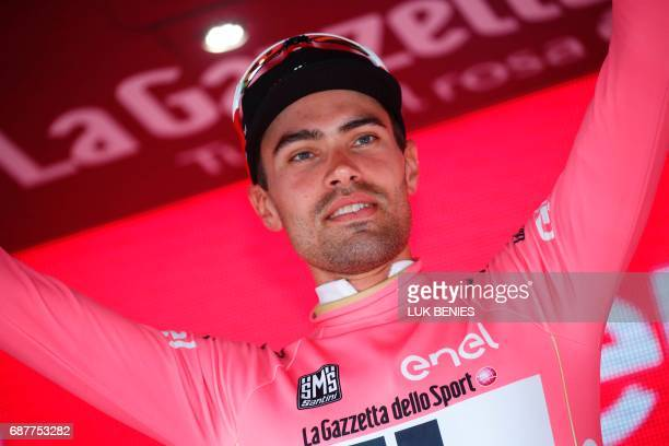 Netherlands' Tom Dumoulin celebrates the pink jersey of the overall leader on the podium after the 17th stage of the 100th Giro d'Italia Tour of...