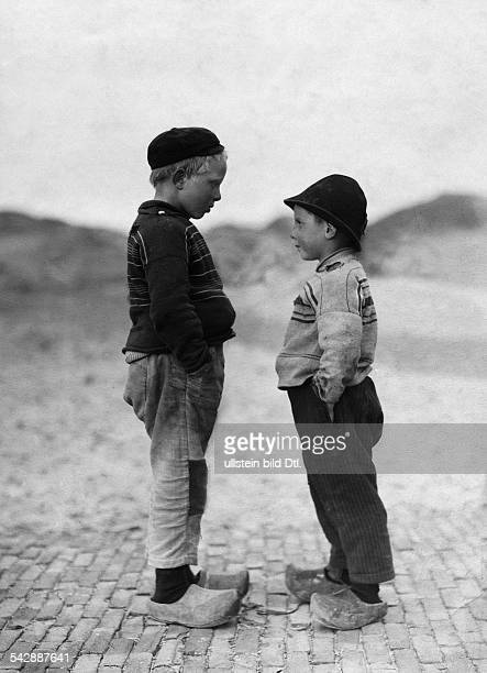Netherlands two boys in clogs date unknown around 1909photo by Becker MaassPicture belongs to a series of photographs