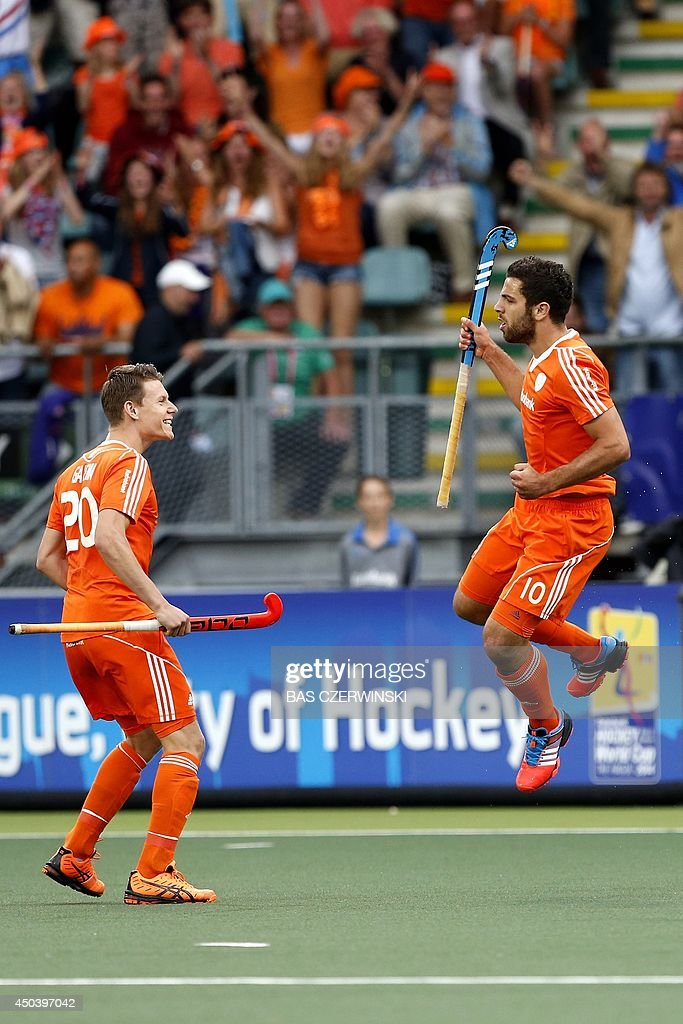 Netherlands' Valentin Verga (R) celebrates his goal with teammate Jelle Galema (L) during the stage group match between Netherlands' and New Zealand of the men's tournament of the 2014 Field Hockey World Cup in The Hague, on June 10, 2014.