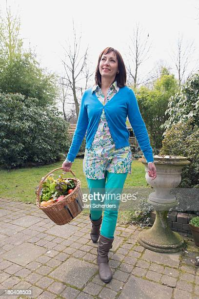 Netherlands, Venlo, Mature woman with fresh vegetables in basket